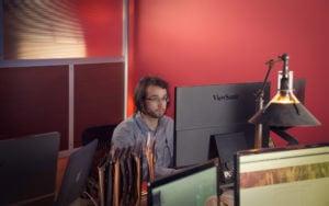Aaron working at his desk