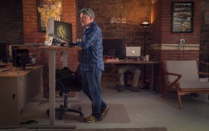 Peter working at his standing desk