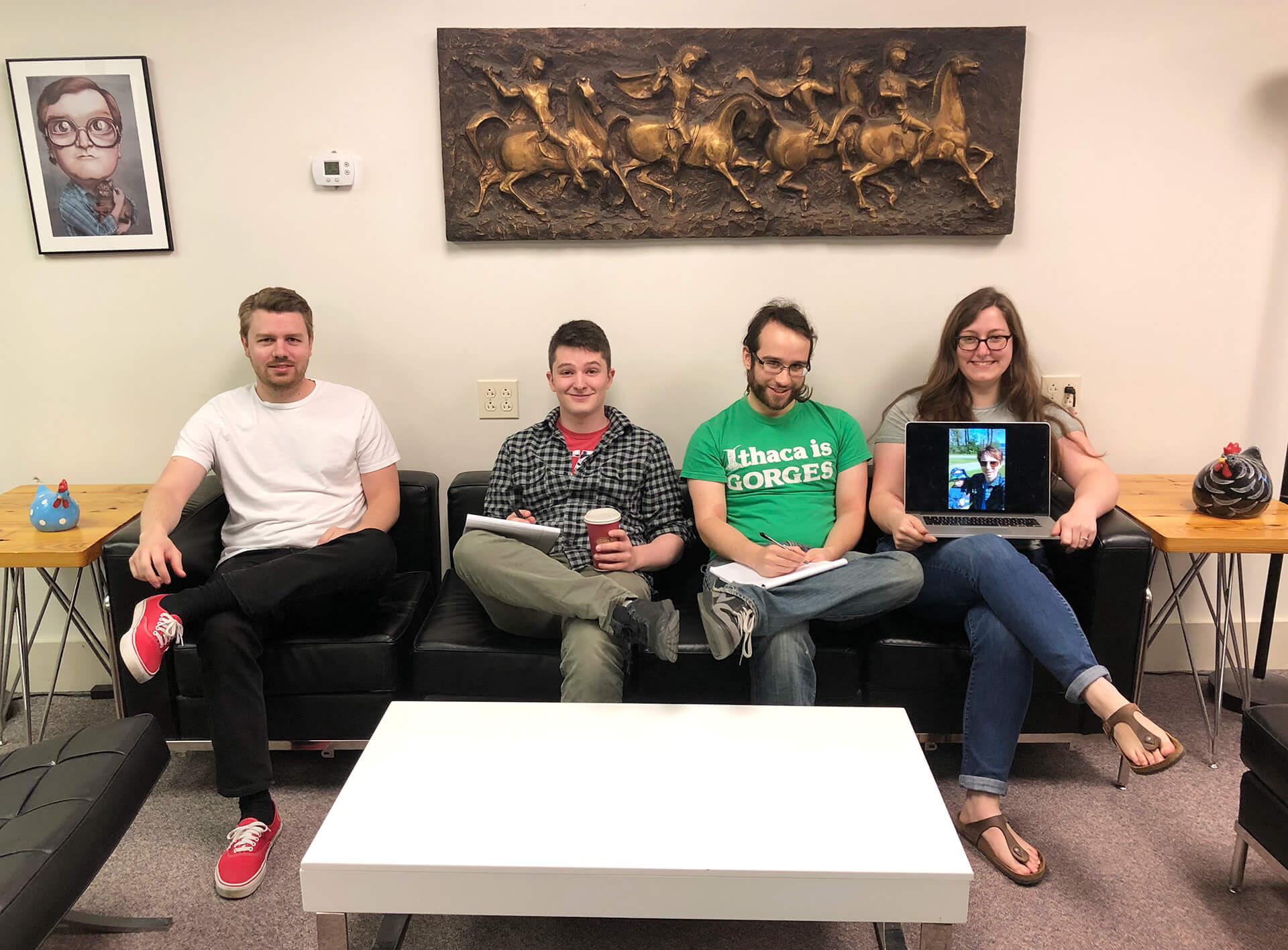 Bytes support team members sitting on a couch
