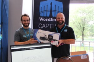 Photo of Matt Barry and Aaron Silber holding the first-place prize for the Wordfence CTF