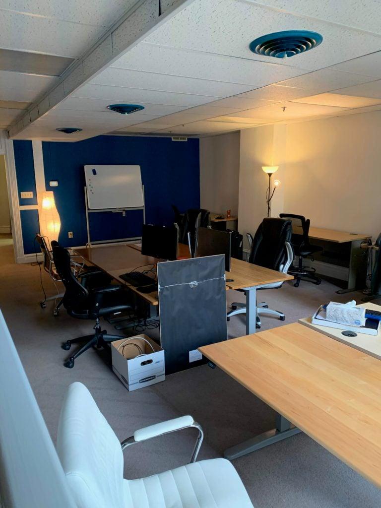 Desks in the second floor dev room