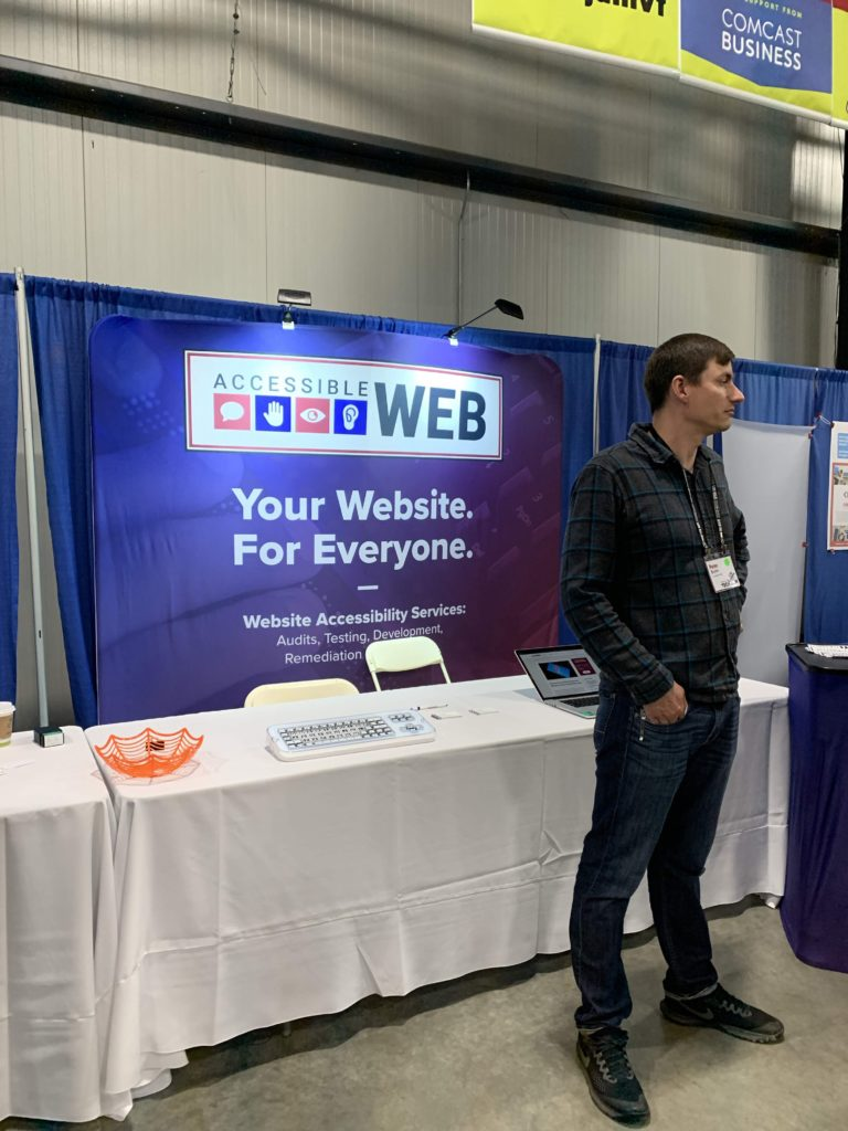 Pete bruhn at the Accessible Web booth at Tech Jam
